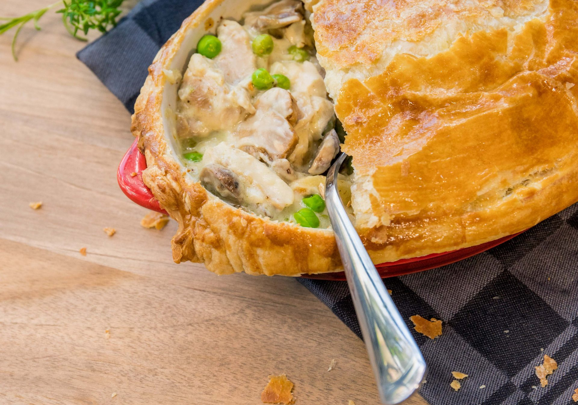 Pie with mushrooms and peas with a spoon