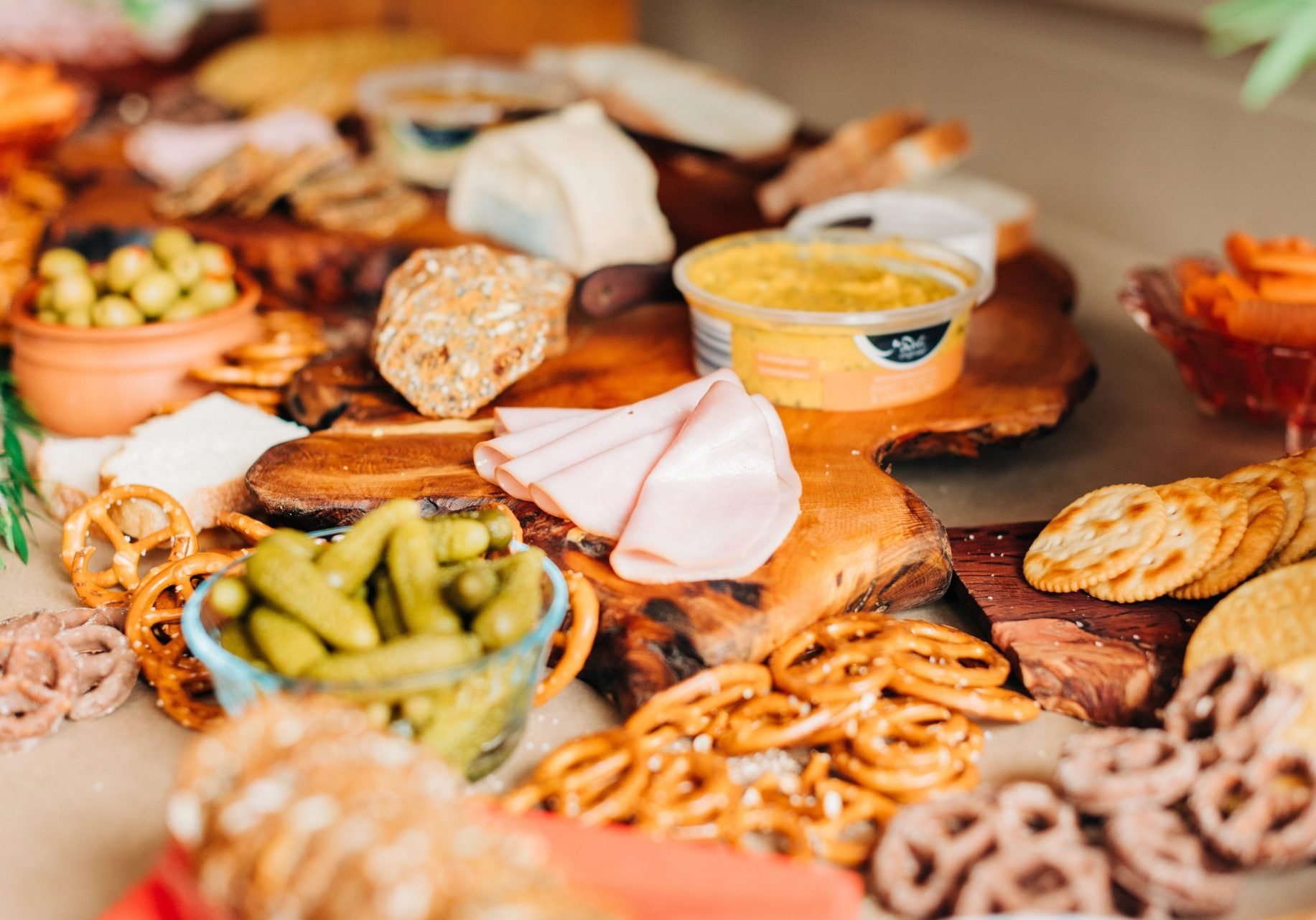 wooden plate with cold snacks